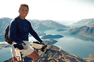 Founder and owner, David Peters at the top of Mt Roy overlooking Lake Wanaka, South Island, New Zealand.